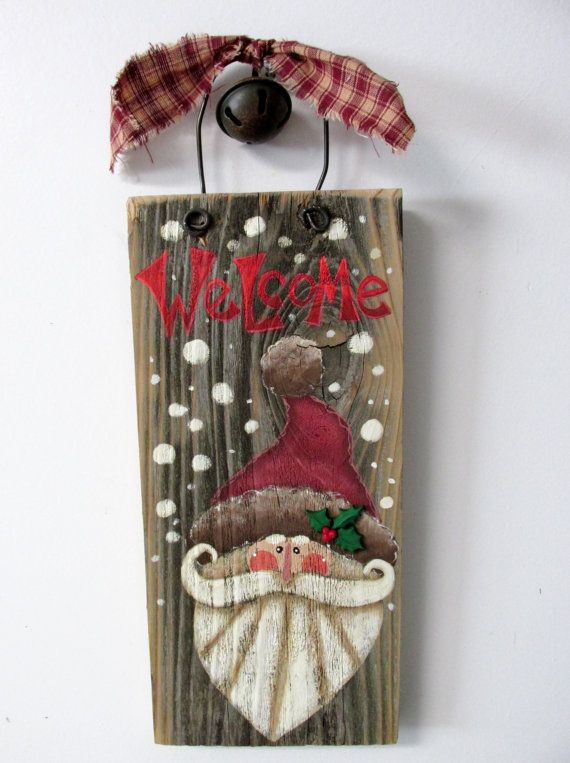 Rustic Santa Welcome Sign, Red Welcome, Hand or Tole Painted, Green Holly and Berries, Reclaimed Barn Wood, Christmas Sign, Folk Art Santa  This Red WELCOME Santa sign is based on a Susan Jill Hall design. It has been adjusted and adapted to fit on to a piece of old reclaimed barn wood. The barn wood measures 12 inches tall x 5 1/2 inches wide and is 14 1/2 inches tall to include the fencing wire. Fencing wire is used as a hanger and has a rusty metal jingle bell and a piece of homespun…