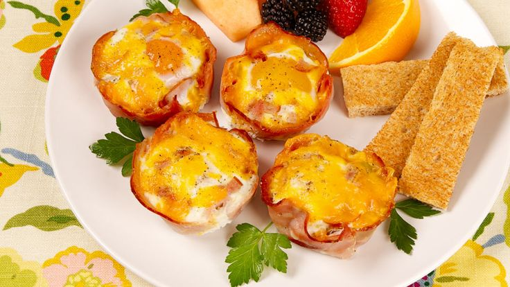 Baked Egg Cups - Recipes - Best Recipes Ever - Put the eggs in the oven, pour the orange juice, then pop the bread in the toaster so everything is ready to serve together.