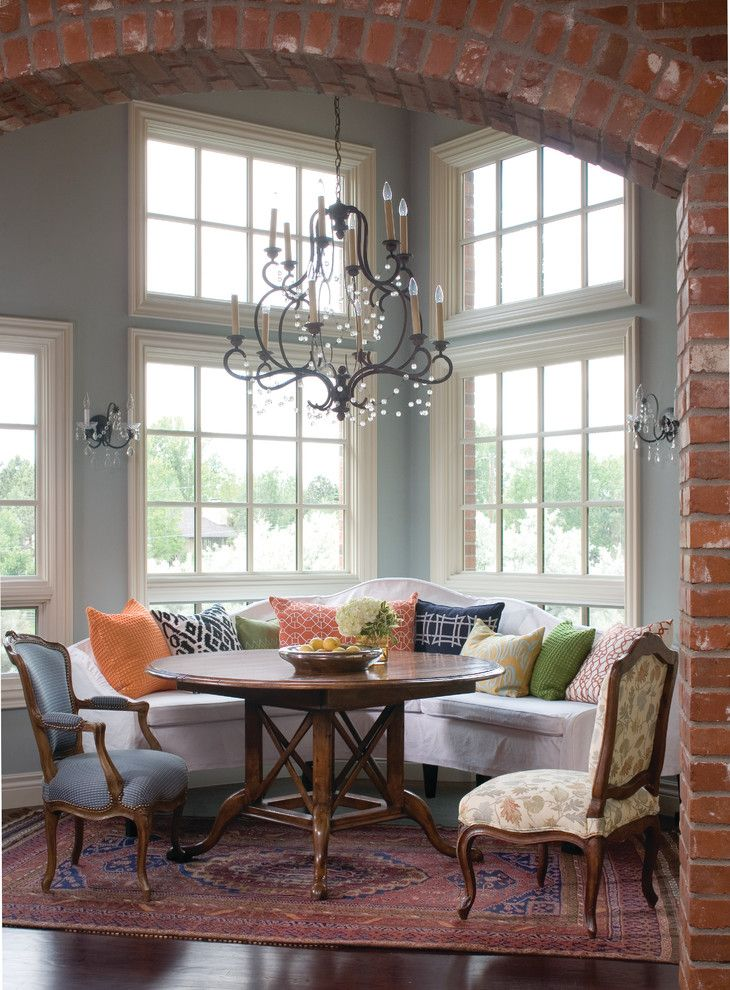 Awesome Banquette Style Dining Space With Beautiful Round Wood Table And  Various Seating Options, Along With Very Pretty Chandelier And Exposed  Brick, ...