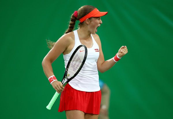 Jelena Ostapenko Photos Photos - Jelena Ostapenko of Latvia reacts against Samantha Stosur of Australia in their first round match on Day 2 of the Rio 2016 Olympic Games at the Olympic Tennis Centre on August 7, 2016 in Rio de Janeiro, Brazil. - Tennis - Olympics: Day 2