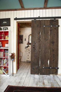 Barn door, teal ceiling w/wood trim