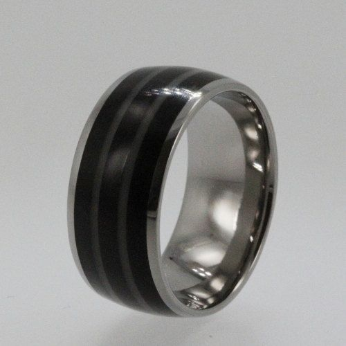 titanium ring inlaid with african black wood and tagua nut 19900 via etsy - African Wedding Rings
