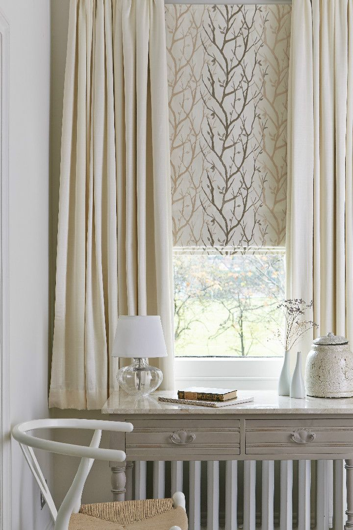 Beautiful made-to-measure blinds and curtains layered together and in neutral colours create a calm simplistic feel in any home. These can look great in a dinning room or bedroom! If you want to brighten it up a bit, add colour with accessories.