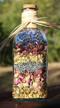 Dried Organic Flowers in a Recycled Green Glass Bottle with Cork and Raffia. , via Etsy.