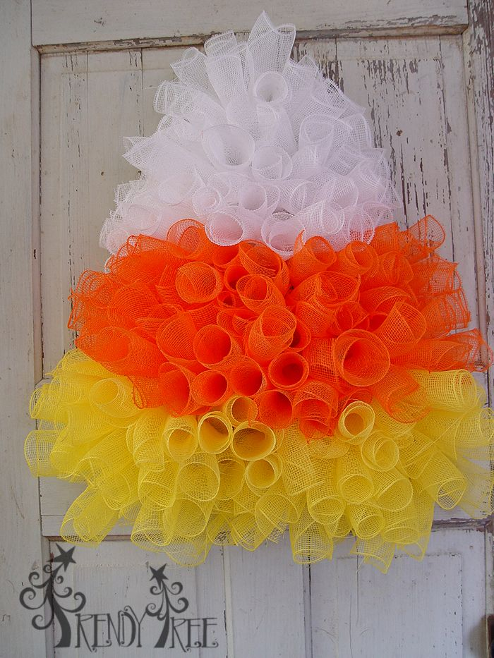 Video and written tutorial for a Halloween Candy Corn Wreath using an Open Tree Form, Orange, Yellow and White Deco Poly Mesh, RAZ Witch Hat and Legs or Fabric Hanging Witch Legs.
