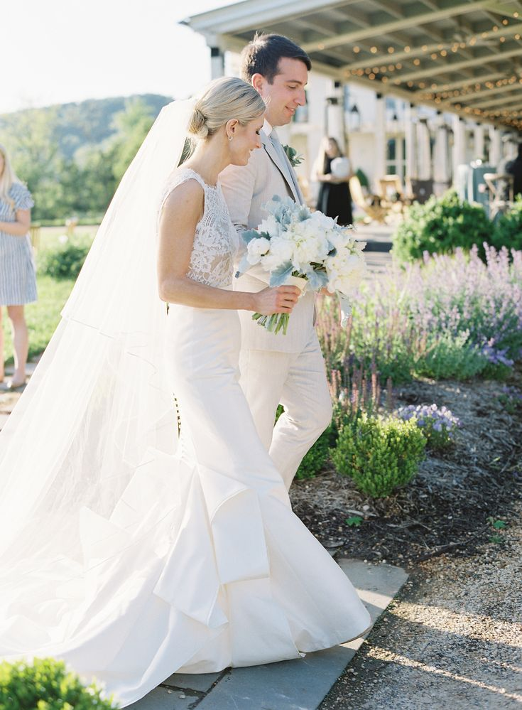 White lace mermaid wedding gown with a white rose and blue hydrangea bouquet at Pippin Hill Farm & Vineyards | Photographer: Laura Gordon |PLANNING: The Social Office (DORI) | FLORIST: Hedge Fine Blooms | HAIR + MAKEUP: Avenue 42