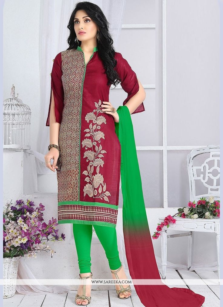 Be your distinct style diva with this green and magenta cotton   churidar suit. The ethnic embroidered work with a dress adds a sign of magnificence statement for the look. Comes with matching bottom ...