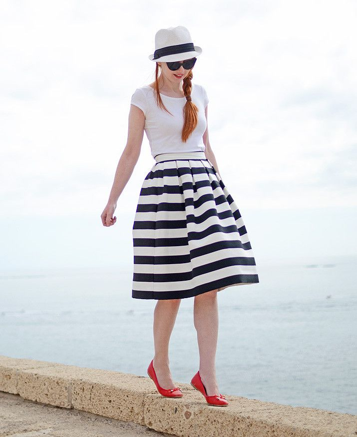 summer vacation outfit: black and white stripe midi skirt with red ballet flats and white hat, for a vaguely nautical look, perfect for a day by the seaside (or balancing on a wall, as the case may be...)