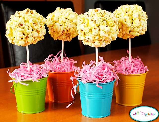 Party centerpieces- Popcorn ball trees~try a little food coloring to tint balls theme color & you could also add a bow made out of tulle.