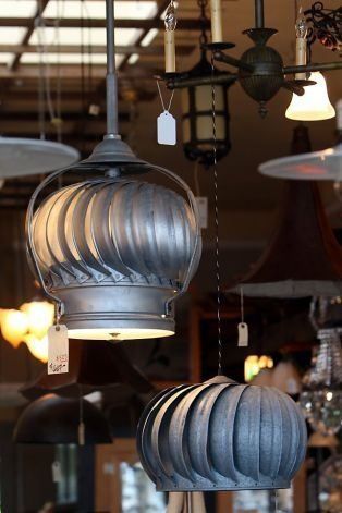 Lamps made from outdoor house fans hang in Omega Too, a unique lighting store in Berkeley, CA Tuesday November 1, 2011. Omega Too specialize in restoring vintage lights and custom building lighting fixtures made from used and repurposed materials. Photo: Erin Lubin, Special To The Chronicle / SF