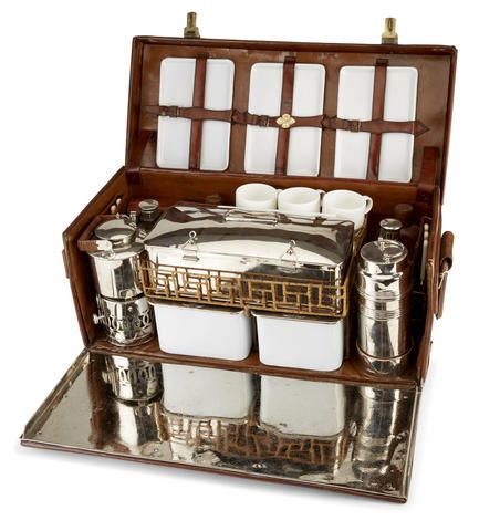 "A late Victorian 'en route' fully fitted picnic set for four, late 19th century, retailed by Drew & Sons, Picadilly Circus, London, case inscribed ""J.H.R.Y"","