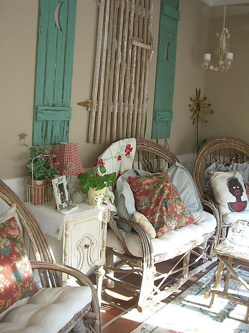 Kathy's home... love the aqua shutters and willow furniture