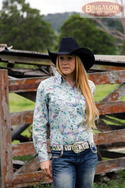 http://brigalowcountry.com.au/girls-western-western-shirt-henty-hue.html This 100% cotton, light coloured paisley print girls shirt features beautifully contrasting purple highlights. Brigalow's regular western cut has longer shirt tails and sleeves to accommodate more comfortable riding.