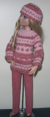 Hand knit designer ski sweater & hat + slacks.