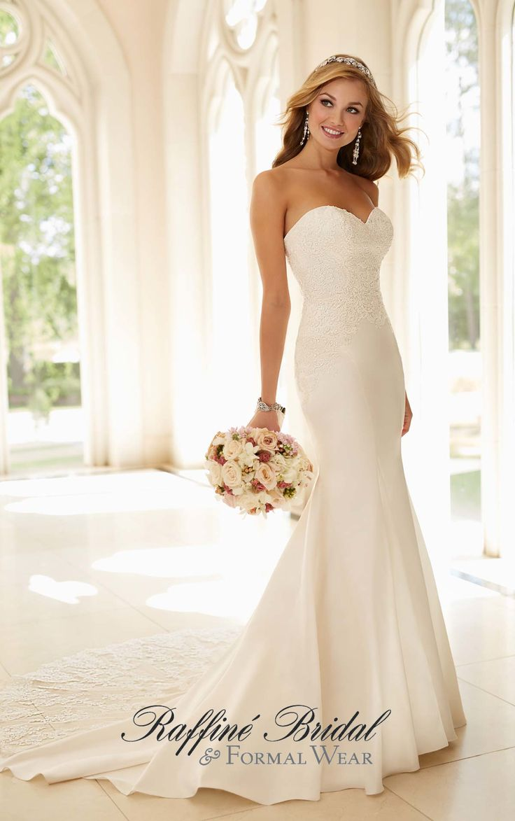 Stella York #6236 - Fit and flare satin wedding dress with lace adorned bodice and strapless sweetheart neckline.