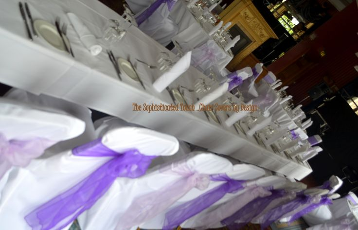 Alternating Cadburys Purple Organza and Lilac Organza Bows on White Chair Covers  The Sophisticated Touch ...Chair Covers by Design