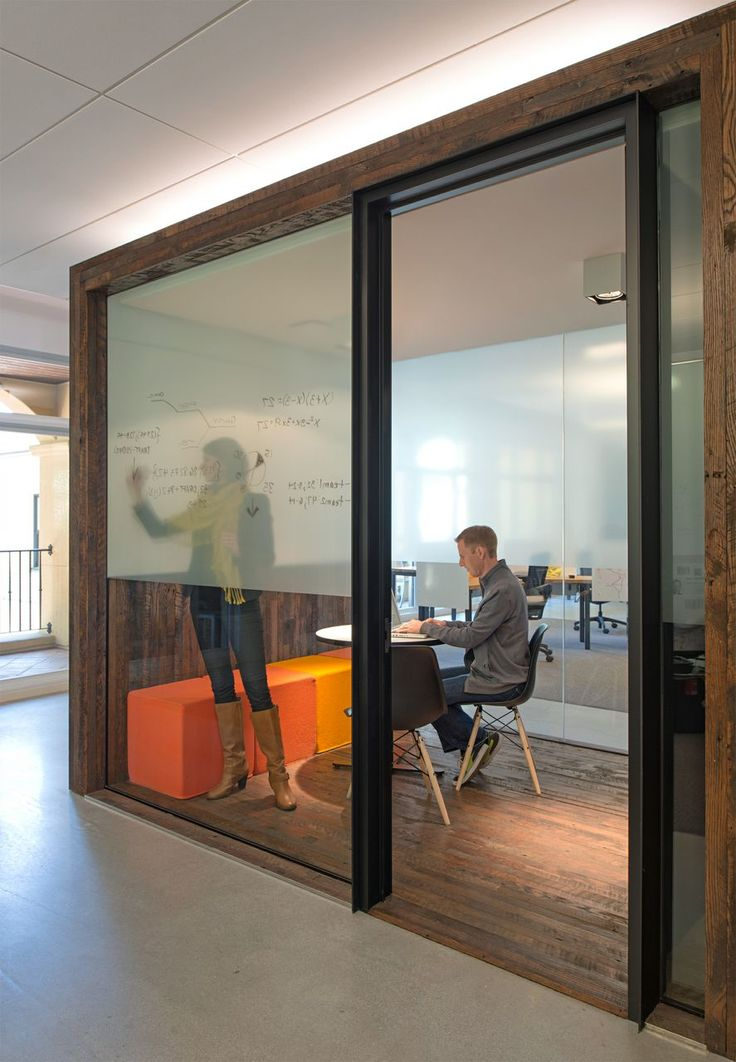 Small Conference Room---I love this idea with the dry erase sheer cover on the glass walls--giving privacy and function but also letting in light from other spaces