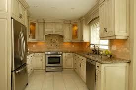 cream kitchen cabinets with chocolate glaze, stainless appliances