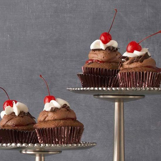 These Black Forest Cupcakes have luscious cherry fillings and creamy cocoa butter frosting. More cupcake recipes: http://www.bhg.com/recipes/desserts/cupcakes/our-favorite-filled-cupcakes/