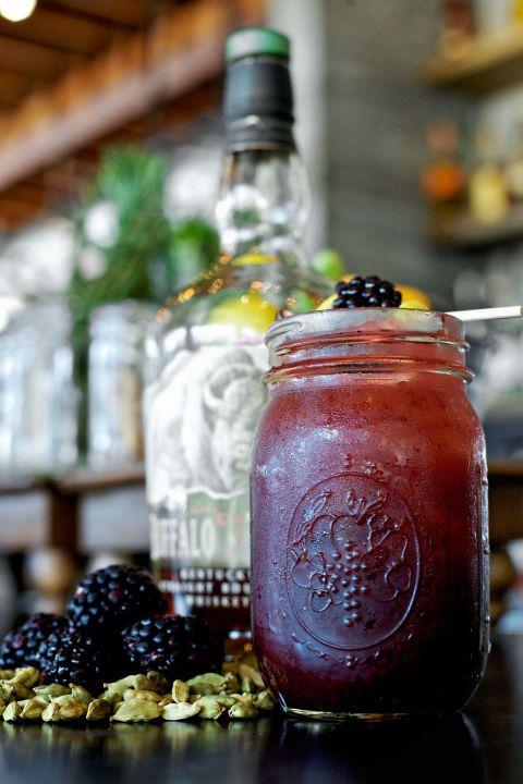 Try this Blackberry Bourbon Lemonade...in a mason jar, no less! The ingredients are: Mason jar drinks are the best kind of summer drinks. Ingredients: Bourbon, Fresh Lemon Juice, Simple Syrup, Blackberry Puree, Cardamom Pod, Sparkling Wine, Lemon Wheel and Fresh Blackberry,