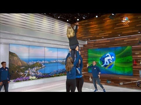 Alev Kelter, Jessica Javelet, Carmen Farmer and Katie Johnson of the U.S. Women's Olympic rugby sevens team involve NBC presenter Carolyn Manno in a lineout demonstration.