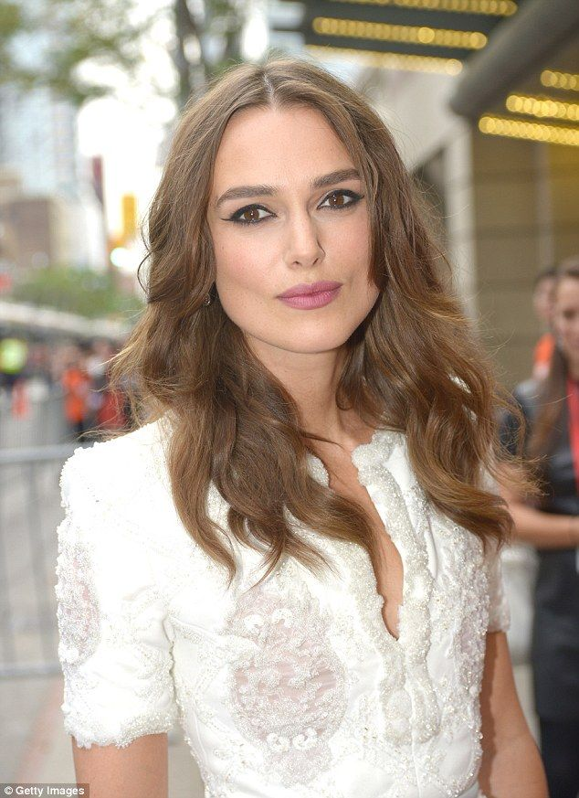 Brunette beauty: Keira was a vision on the red carpet wearing a simple cat eye make-up look and pink lips