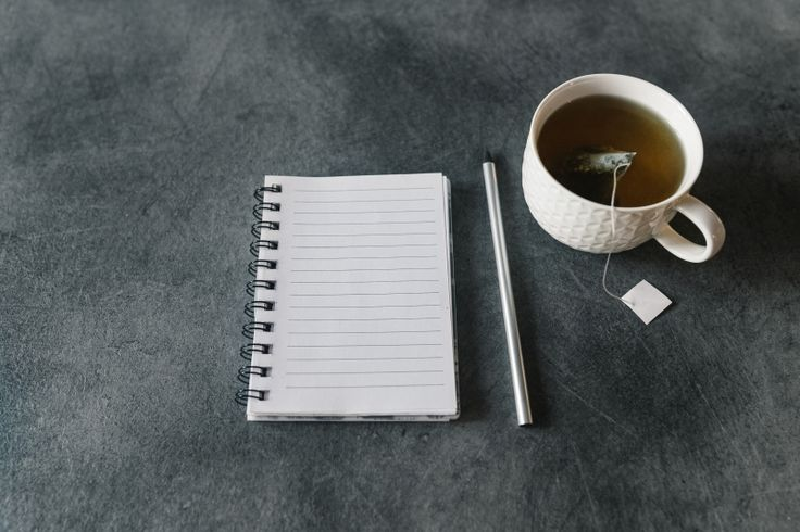 FREE STOCK PHOTO: Blank empty notepad, pencil and cup of tea on grey desk II
