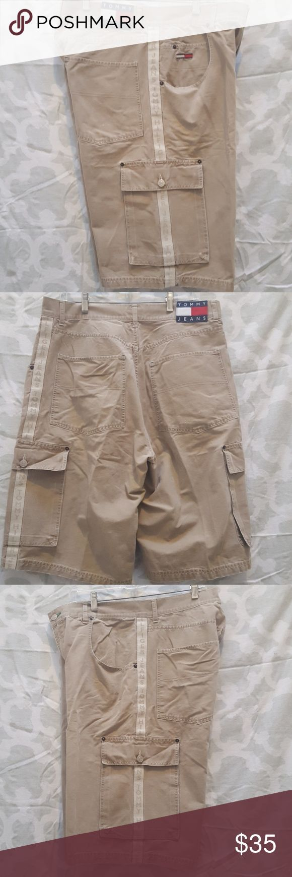 VINTAGE 1999 Tommy Hilfiger cargo shorts For sale is a used pair of Vintage Mens Tommy Hilfiger Tommy Jeans Khaki colored demim cargo shorts.  Production date: 12/1999  They are a mens waist size 36  Shorts are in good condition for its age just normal wear from wash. Minor flaws noted. Small surface scratches on back pocket. Please see last picture. May have if any loose threads. Great piece to own! Be sure to pick this up today!  Offers welcomed using offer button.   NO TRADES.  NO…