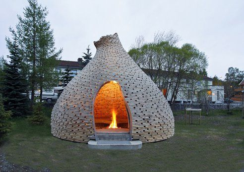 Gorgeous Norwegian Outdoor Fireplace combines reuse with local traditions. The perfect place for the neighborhood kids to warm up.