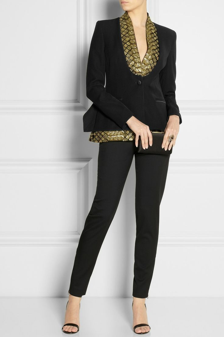 ALTUZARRA St Michel embellished crepe blazer $3,995 A nod to '70s glamor, Altuzarra's mid-weight crepe blazer is heavily embellished with gold beads and sequins. We love the sharp silhouette – strong shoulders complement the wide lapels and layered peplum back hem. Wear yours for evening with tailored pants.  Shown here with: Bijoux Heart ring, Stella McCartney pants, Alexander Wang shoes, Kotur clutch.