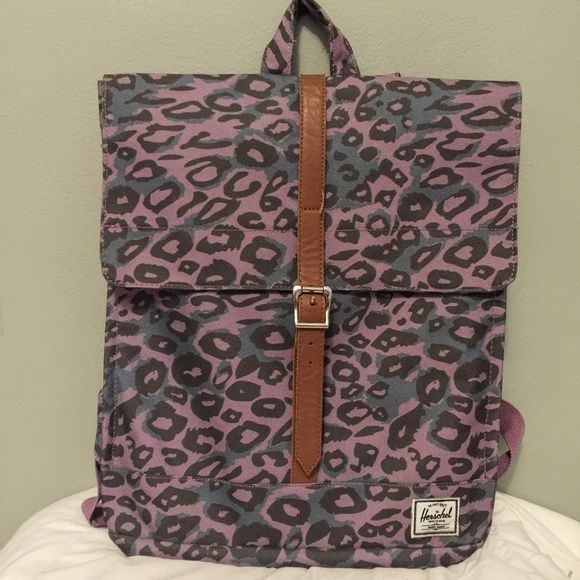 "Herschel ""City backpack"" in purple Super cute purple cheetah print backpack. Amazing condition, a little spotting in the inside but the outside is in amazing condition! Add a little flare to your daily school wardrobe ☺️ Herschel Supply Company Bags Backpacks"