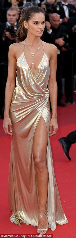 69th CANNES FILM FESTIVAL IZABEL GOULART. Spectacular: Completing her dazzling look, Izabel wore strappy gold stilettos...