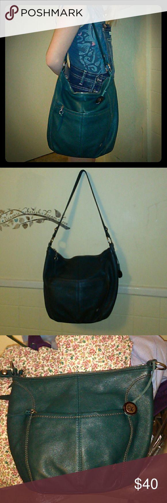 The Sak Olive Green Leather Hobo Handbag The Sak Olive GreenLeather Hobo Handbag. Has zipper pocket on front, small pocket on back &   zipper pocket and 2 pockets on inside. Excellent condition. The Sak Bags Hobos