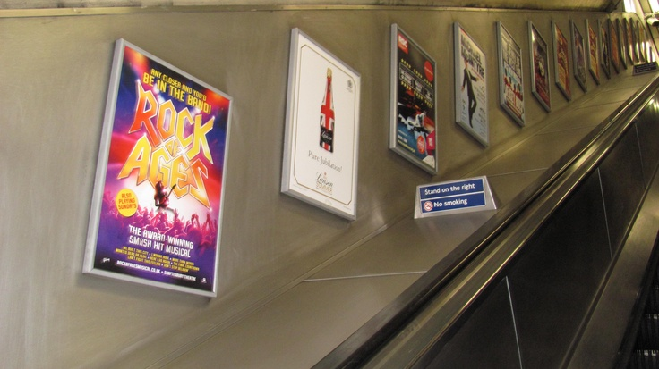 advertisements along the escalators in the underground stations