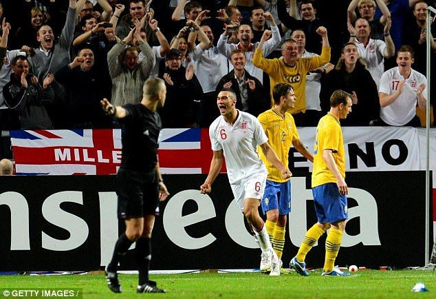 Caulker celebrates scoring against Sweden in his only appearance for England's national team