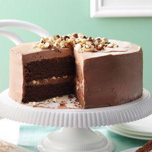 Mocha Hazelnut Torte. Cake: butter, brown sugar, unsweetened chocolate, espresso powder. Frosting: Nutella, hazelnuts, butter, confectioners sugar. Taste Of Home Magazine.