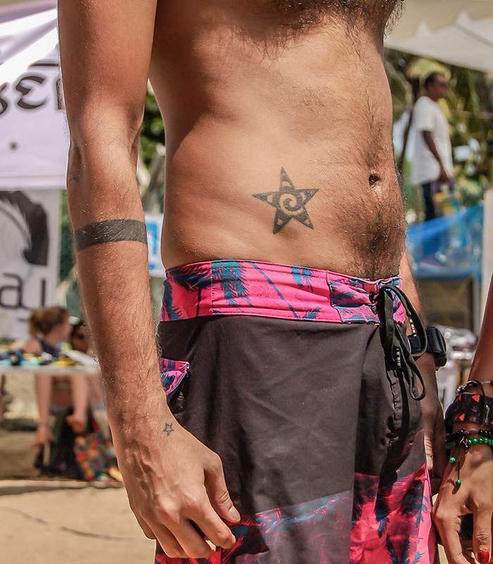 DANGEROUSLY LOW SLUNG SHORTS, STACKED BRACELETS + TRIBAL INK = PERFECT SUMMER JAM  #Summer #Beach #FastrackBlog