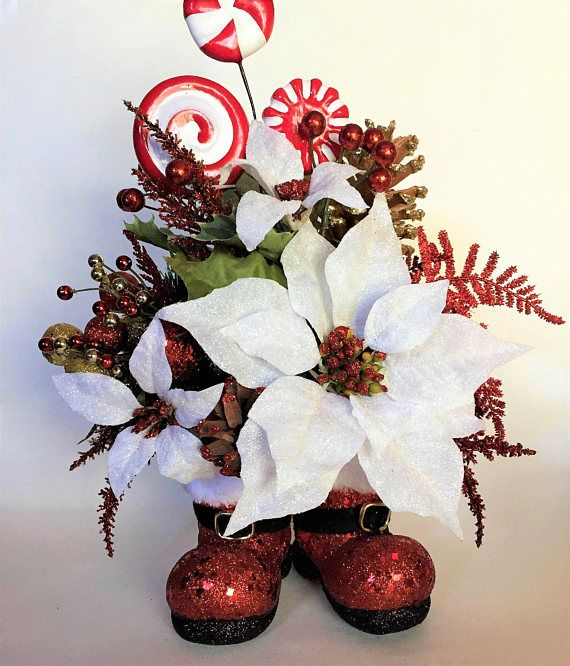 Santa Boots Floral Arrangement White Poinsettia Holiday Floral Holiday Centerpiece Holiday Decor Santa Floral Santa Claus Gift Ideas Holiday Centerpieces Diy Christmas Wedding Centerpieces Holiday Floral
