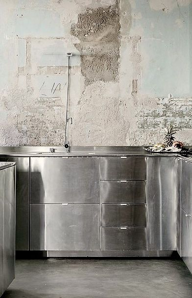 stainless steel cabinets, concrete walls & floor