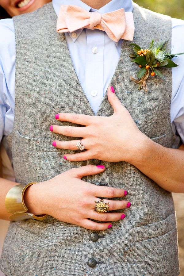 Her jewelry, his suit, her nails. Love.
