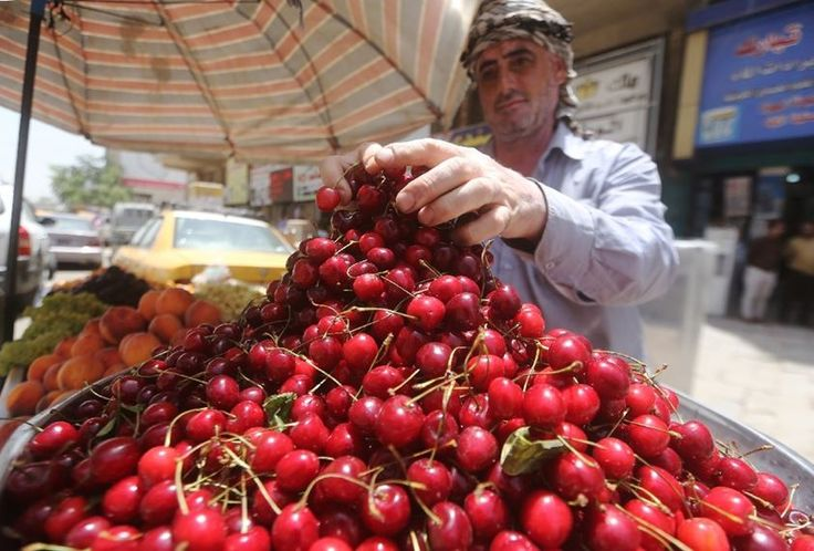 An Iraqi vendor sells fruit in a street of Baghdad during Islam's holy month of Ramadan