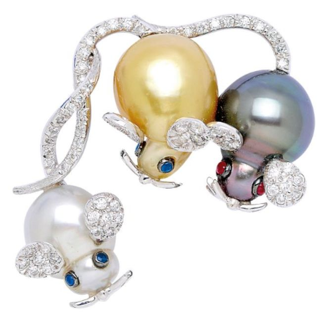 A Multi-Coloured Cultured Pearl and Diamond Mouse Brooch The whimsical trio of frolicsome mice with white, golden and black baroque cultured pearl bodies and heads, sapphire and ruby eyes, diamond-set ears and tails, mounted in 18k white gold.