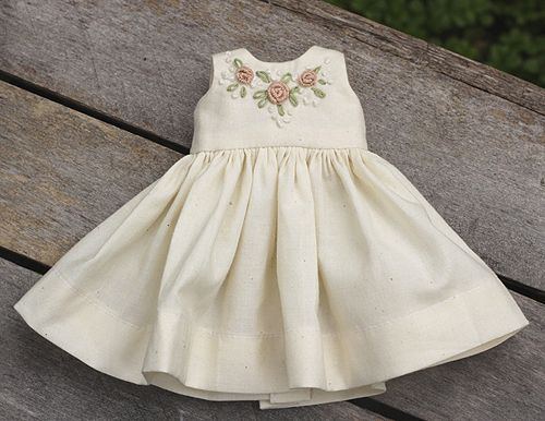 Simple free doll dress pattern. The pattern can be scaled up or down, on a printer, to fit a small doll or American Girl Doll .