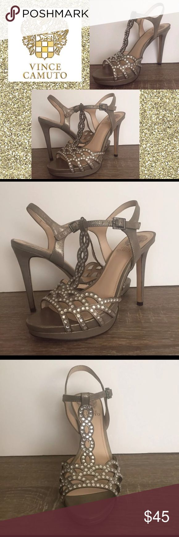 Vince Camuto Cristiana Women's Platform Metallic Perfectly perforated with eye-catching laser-cut geometric details and rhinestone embellishments, the party star Cristiana sandal offers an alluring way to showcase a little skin.  Details: -In good pre-owned condition. Small scuffs around shoes. Please see pictures -Size: 5 1/2 -Color: Metallic Silver -Leather upper, man-made lining, and sole adjustable buckle, light texture Vince Camuto Shoes Platforms