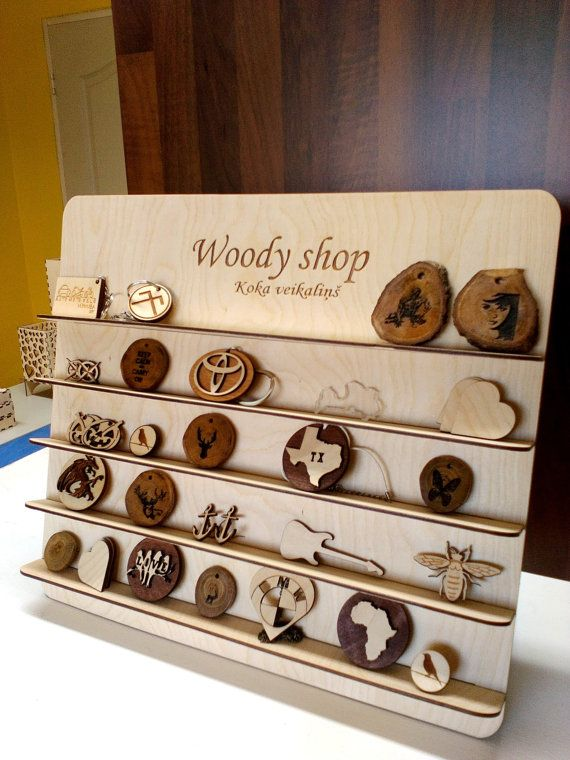 This listing is for wooden jewelry stand with your engraved logo or name. This is very nice gift for your shop!!!  * Item details: Height: 33,5 cm ( 13.1 Inches) Width: 40 cm (15.7 Inches) Size between shelves: 5 cm ( 1.9 Inches) Shelf width: 3cm ( 1.1 Inches)