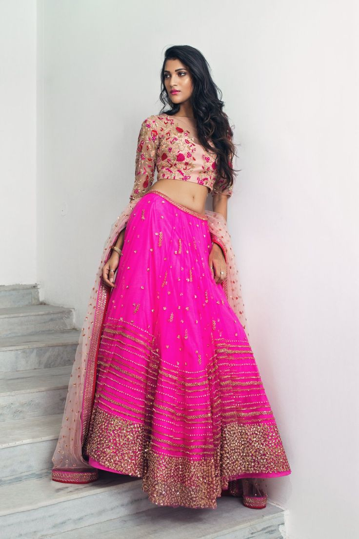 Pink isn t just a colour. It s an attitude.Issa contemporary lehenga in dazzle pink hand embroidered to perfection to keep that poise pouring out of you. Jewellery Courtesy: Sitara Jewellery They can customize the dress as per your requirement. For more detail 04 March 2018