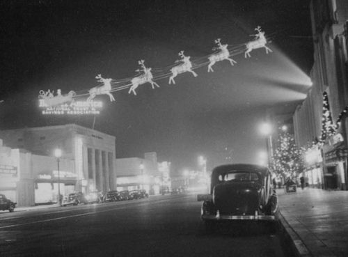 Santa and his reindeer on Main Street, 1940s
