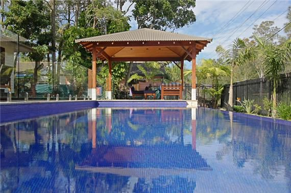 Photo of Away on Shirley Lane  not sure of the shower/bath in the middle of the bedroom.  http://www.rent-a-home.com.au/accommodation/nsw/byron-bay---northern-rivers/byron-bay/61765