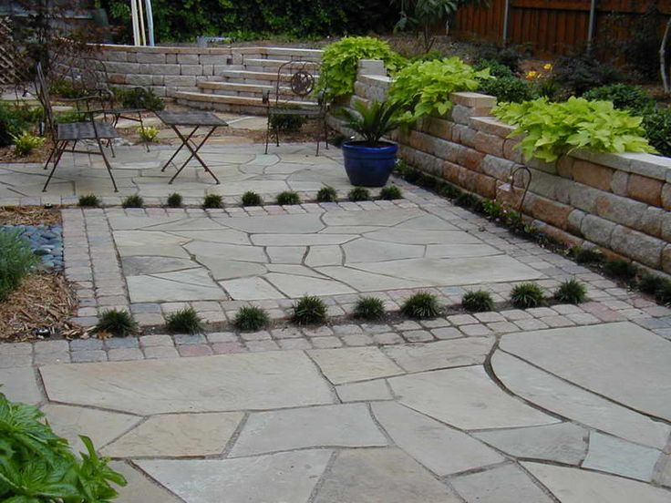 How to Lay Flagstone Patio for New Building With Stone Wall