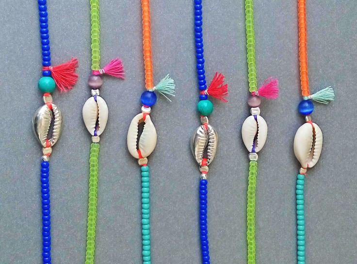 Shell bracelet - Neon yellow and purple  - Pink tassel - Natural cowrie shell - Sterling silver - Handmade - Summer bracelet - sea jewelry by AvitalKatzArt on Etsy
